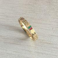anéis de casais vermelhos venda por atacado-New deluxe moda marca de design de prata de ouro prata verde vermelho casal casal anéis de jóias para mulheres homens casamento presente de noivado frete grátis