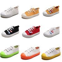 zapatos de lona de los niños de color naranja al por mayor-Zapatos sin marca lona de los niños para Niños Niñas resbalón en los zapatos ocasionales de la galleta de Whtie Negro Rojo Naranja colores del caramelo 20-31 estilo al por mayor de 1