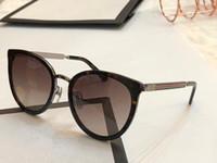 quadros de metal encantos venda por atacado-Novo Designer de Moda Óculos De Sol 0077 armação de metal das mulheres populares óculos de olho de gato qualidade superior charme estilo UV400 marca eyewear com Pacote