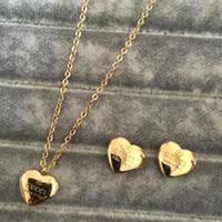 ingrosso collane in oro di disegno dei monili-Gioielli di alta qualità di design collane Orecchini Imposta gioielli in titanio acciaio placcato in oro 18 carati 3 colori collana pendente per le donne regalo