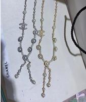 ingrosso maglioni di perle neri-Elegante catena donne maglione Perla Numero Nero Bianco dello smalto dei monili del fiore della camelia collana del partito della ragazza delle donne Accessori