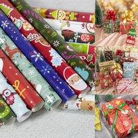 papel de regalo de santa navidad al por mayor-Papel de envolver de Navidad Decoración de Navidad Caja de regalo de bricolaje paquete historieta del papel de Santa Claus muñeco de nieve ciervos Presente Papel de envolver RRA2440