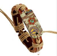 pulseira de tecido chinês venda por atacado-Pulseira de couro 12 pçs / lote paz corda de couro tecelagem estilo Chinês pulseira cruz pulseiras religiosas para mulheres dos homens KKA2578