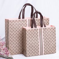 Wholesale store bags resale online - Coated clothing store portable Shopping non woven shopping bag customized advertising non woven bag