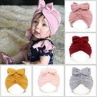 Wholesale purple newborn hat for sale - Group buy 9 Colors Cute Infant Toddler Unisex Bow Knot Indian Turban Cap Kids Modal Cotton Caps Baby Donut Hat Solid Color Hairband Cap M2460