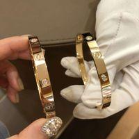 Wholesale cloisonne bangles resale online - Men s bracelet L titanium steel bracelet designer bracelet high quality jewelry female designer jewelry K gold diamond inlay wit