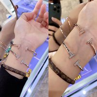 Wholesale gold bangles models for sale - Group buy Sterling silver bracelet female opening double T T red star networks with simple models rose gold bracelet personality minority cold wind