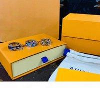 Wholesale enamel flower rings resale online - Top Quality Luxury L Titanium steel Ring High Quality Engrave Four Leaf Flower Colored Enamel Design Ring Man Woman Ring