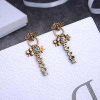 2020 New D letters five-pointed star bee earrings women's personalized fashion diamond-encrusted brass earrings