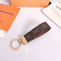 Wholesale golden key chain for sale - Group buy Luxury keychain designer unisex key chain real leather with stainless steel keychain keyring in Golden with brown with box