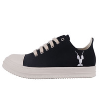 Wholesale cloth labels for sale - Group buy Trendy shoes classic black and white embroidery men s shoes thick soled increased sports and leisure claw label low cut canvas women s shoe