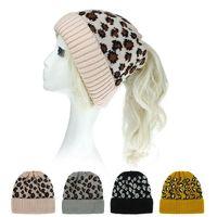 Wholesale cuffed knit hat resale online - Leopard Cuff Ponytail Messy Bun Beanie Women Winter Warm Soft Knit Beanie hat styles LJJK2494
