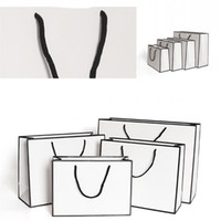 Wholesale clothing shops for sale - Group buy Kraft Paper Thicken Bags White Card Packaging Bag Advertising Fashion Storage Handbag Shopping Party Customized Clothing gr B2