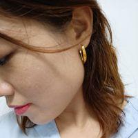 Hoop earrings bamboo earrings high polish 18k gold designer jewelry A summertime hoop if we have ever seen one.