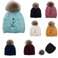 Wholesale ponytail beanie resale online - Women Pompom Beanie Cross Criss Ponytail Hat Girls Warm Ski Cap Winter Soft Knit Messy Bun Beanie DDA631