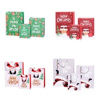 Wholesale cosmetic bag designer resale online - Paper Christmas Gift Bag Cartoon Printed Merry Christmas Shopping Gift Bag Jewellery Cosmetic Stuff Bag with Handle S M L EWA1109