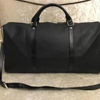 free shipping men duffle bag women travel bags hand luggage travel bag men pu leather handbags large bag totes 55cm
