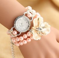 Wholesale fashion pearls bracelet wrap for sale - Group buy New Luxury Women Watches Fashion Personalized Flowers Pearl Wrapped blossom Shiny Rose Bracelet Watch Quartz Wristwatches