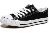 ingrosso prezzi elevati-Prezzo promozionale prezzo di fabbrica! Femininas scarpe di tela da donna e da uomo, alta / bassa stile classico scarpe da ginnastica scarpe da ginnastica scarpe di tela