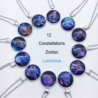 encantos leves venda por atacado-Zodíaco Luminoso Pingente Colares 12 Sinal Constellation Cabochon De Vidro Luz Azul no Presente Charme Escuro Colar de Jóias Por Atacado