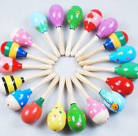 mejor bebé sonajero al por mayor-Juguete de bebé de colores Maracas de madera Sacudidores de huevo Juguete musical Sonajero de bebé Juguete educativo temprano Mano Trainning Mejores juguetes para niños Envío gratuito