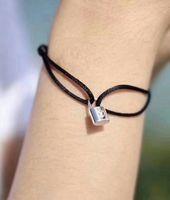 ingrosso braccialetti d'argento liberi-La corda fatta a mano delle donne di marca con l'argento di titanio del braccialetto incantano l'accessorio dell'acciaio inossidabile di titanio molti trasporto libero dei monili della corda di colori PS
