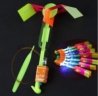 Wholesale copter rocket - 20pcs Hot Funny Shining Rocket Flash Copter Arrow Helicopter Neon LED Flying umbrella Light flash Ejection fly kids toys WJ101