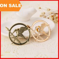 Wholesale Pins Movie - The Hunger Games Brooches alloy Inspired Mockingjay And Arrow Brooch Pins gold Bronze bird badge movie jewelry statement jewelry 170222