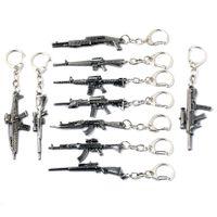 schmuckmodelle ketten großhandel-10 Arten Simulationswaffe Modell Schlüsselbund Pistole Schlüsselanhänger Autoschlüsselring Coole Herren Schlüsselabdeckung Schmuck