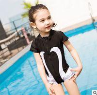 Wholesale Swimwear Girl Sunscreen - Children swimsuit INS girls black swan printed short sleeve sunscreen siamese swimwear kids cartoon tiered falbala beach swimming R0645