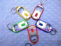 led trousseau pack achat en gros de-100pcs 1LED 2 en 1 ouvre-bouteille de bière LED lampe lumière porte-clés porte-clés porte-clés avec emballage