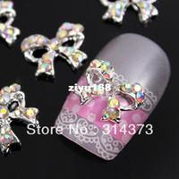 Wholesale 3d Nails Designs Bows - 100PCS LOT Bling Charm AB Crystal Rhinestones Boutique Bow Bowtie 3D Alloy Decor Salon Acrylic Nail Art Tips Design Decoration