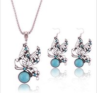 Wholesale Tibetan Butterfly Necklace Turquoise - Wholesale-Fashion personality Tibetan silver hollow out lovely butterfly Crystal pendant necklace Turquoise necklace earrings jewelry set