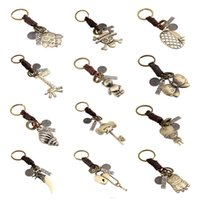 Wholesale Keyring Minions - 13 Style Vintage Braid Genuine Leather Key Chain Owl Minions Conch Pendant Keyring Men Women Lover Key Chains Fine Jewelry DCBJ921