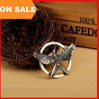 Wholesale Hunger Games Logo - 2 colors Retro Movie Jewelry The Hunger Game Bird Brooches pin metal Mockingjay Pins Hero logo jewelry for men women Halloween gift 170221