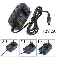12v wandschalter großhandel-DC 12V 2A Netzteil UK / US / AU / EU Stecker Ladegerät Adapter Ladegerät Schalttransformator Für LED Lichtleiste