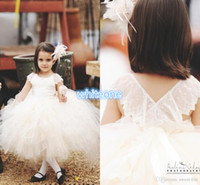 Vintage Flower Girl's Pageant Ball Gown 2016 Cute Children Свадебная вечеринка Платья для вечеринок Sheer Neck Cap Sleeve Tutu Tea Length White Tulle