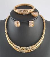 ingrosso african costume jewelry-Set di orecchini di gioielli africani di alta qualità placcati in oro placcato pieno di strass bracciali orecchini anelli