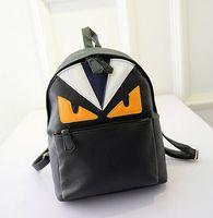 Wholesale Brown Bucket Handbags - 2015 new shoulders bag small fresh College Wind handbag Little monsters leisure travel PU backpack.