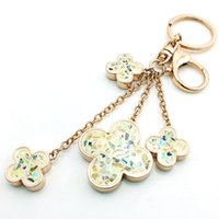 JINGLANG Fashion Lobster Clasp Keychain Gold Plated Dangle Shell Quatro Folhas Clover Chains Key Rings Jóias de luxo