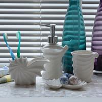 Wholesale white dish sets - Solitudes Ocean Surf Conch Shell Bathroom 4pcs Set White Ceramic Wash Toiletry Kit Cup +Lotion Bottle +Brush Holder +Soap Dish