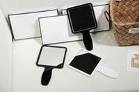 Wholesale Cosmetic Cases Designer - Fashion brand 2 color acrylic luxury cosmetic mirror elegant hand mirror beauty makeup toiletry designer portable mirror boutique VIP gift
