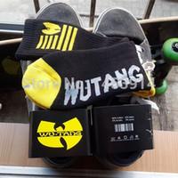 Wholesale Hip Hop Gear Wholesale - Wholesale-wu tang clan black and yellow long casual socks street wear Skateboard fixed gear sport men women hip hop cool meias socks soks