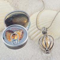 neue perlenhalskettenentwürfe großhandel-PEARL Cage Anhänger Halskette 2018 neue Liebe Wunsch natürliche Perle mit Oyster Pearl Mix Design Auster hohlen Medaillon Schlüsselbein Kette Halskette