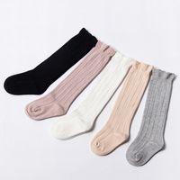 üniforma çoraplar toptan satış-Bebek Tüp Ruffled Çorap Kız Erkek Üniforma Diz Yüksek Çorap Bebekler ve Bebek Tulumları Pamuk Saf Renk 0-3 T