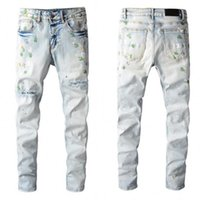 High quality Mens jeans Distressed Motorcycle biker jean Rock Skinny Slim Ripped hole stripe Fashionable snake embroidery Denim pants