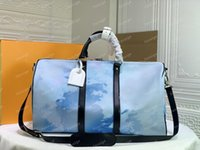 Luxurys Designers Luggage M57486 Fashion Tote Duffel Bags Genuine leather L flower pattern 50cm 2021 style women men Travellling bag