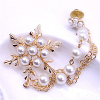 Wholesale Snow Brooch - Snow shaped with pearl brooch Tassels style snowflakes pin Pearl chain corsage Popular exquisite fashion clothing decorative