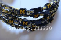 Wholesale Ncaa Titanium Necklace Sport - Wholesale-50pcs lot free shipping NCAA teams sports Titanium Michigan Wolverines sports necklace