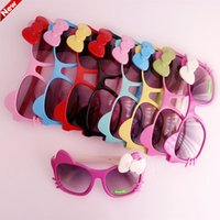 Wholesale Sun Shades For Children - Sun Glasses for Toddlers Kids Plastic Frame Sunglasses Girls Baby Bowknot Cat Eye Shades Goggles Eyewear UV400 Free shipping cheap 201504HX